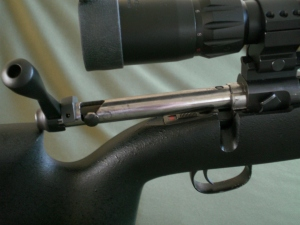 Sliding the new Tactical Bolt Handle into the Action